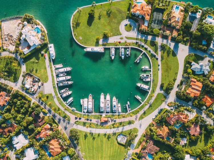 Take a boat ride through the canals to see the mega mansions